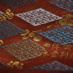 西陣織 金襴 正絹 本金 匂い袋~サビ朱地 武田菱宝尽し紋様