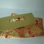 西陣織 金襴 正絹 朱地亀甲丸龍 二つ折りクラッチバッグ