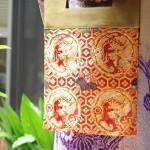 西陣織 金襴 正絹 朱地亀甲鏡裏丸龍 二つ折りクラッチバッグ